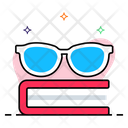 Glasses On Book Icon