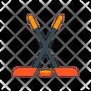 Hockey Sticks And Puck Icon