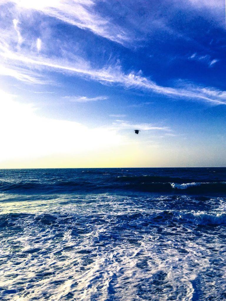 Photography of Water Waves Under Cloudy Sky by   Sadeep Sasanka Photography